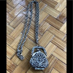 Silver tone filigree purse necklace